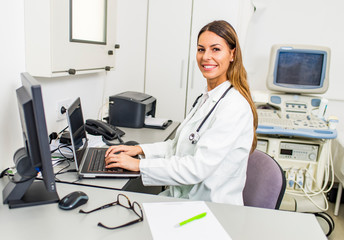 Young doctor with stethoscope in her doctor's office.