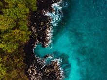 Blue Ocean In Tropics With Rocky Coast. Aerial View.