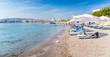 Sun beds and sun shades in Haraki beach – (Rhodes, Greece)
