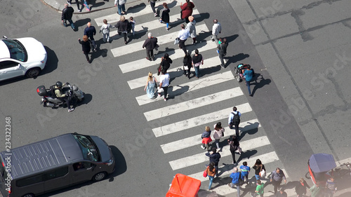 plakat Paris, France - circa May, 2017: Aerial view of pedestrian crossing on street in Paris next to Eiffel Tower