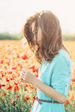 Beautiful Woman With Poppy Flower In The Meadow.
