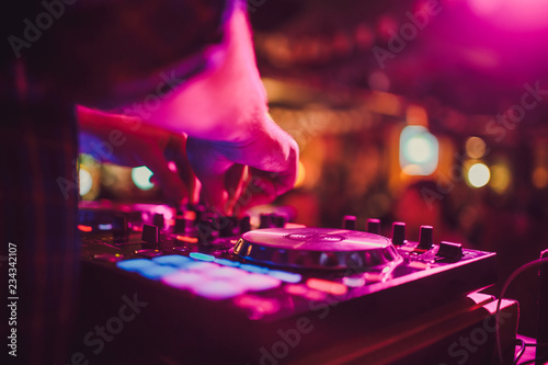DJ remote, turntables, and hands . Night life at the club, party. Tablou Canvas