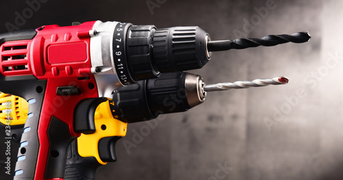 Obraz Two cordless drills with drill bits working also as screw guns - fototapety do salonu