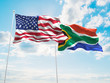 canvas print picture - United States of America, USA & South Africa Flags are waving in the sky with dark clouds