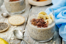 Overnight Banana Oats Quinoa Chia Seed Pudding Decorated With Fresh Banana Slices And Chocolate