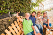 canvas print picture - family group of people caucasian senior and middle age men and woman all together taking a selfie picture with mobile phone technology to share on social network account on internet