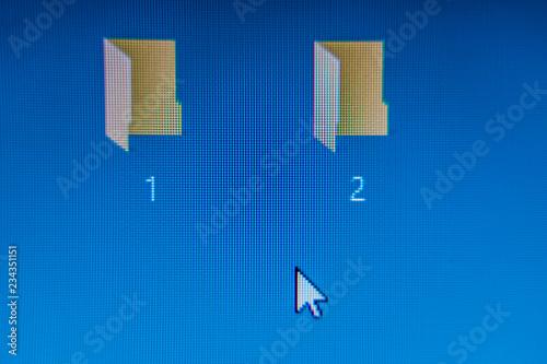 Photo  two digital folders on computer screen