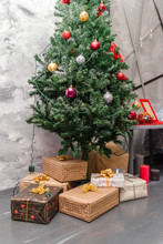Presents And Gifts Under Christmas Tree, Winter Holiday Concept.