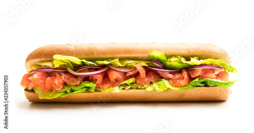 Sandwich with salted salmon and vegetables isolated on white