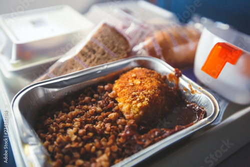 Photo sur Toile Assortiment View of food for the passengers in the air plane, lunch for airline passengers, russian dinner meal menu at airplane