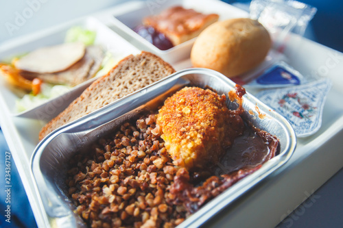 View of food for the passengers in the air plane, lunch for airline passengers, russian dinner meal menu at airplane
