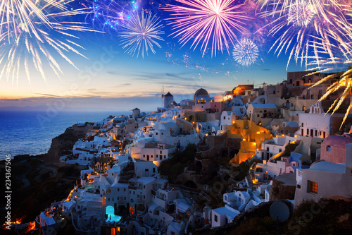 Foto auf Gartenposter Santorini white houses Oia village illuminated at night with fireworks, Santorini, Greece