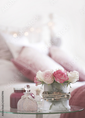 Dusky pink themed bedroom with fresh roses - Buy this stock ...