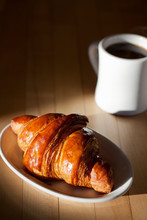 Croissant With A Cup Of Coffee