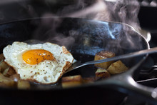 Eggs And Potatoes Cooking On A Pan