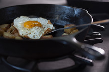Eggs And Potatoes On Cooking On A Pan