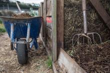 Wheelbarrow And Rake On A Farm