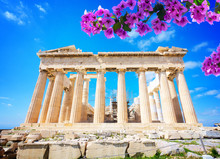 Facade Of Parthenon Temple Over Bright Blue Sky Background With Flowers, Acropolis Hill, Athens Greece
