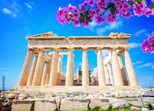 Poster Athens facade of Parthenon temple over bright blue sky background with flowers, Acropolis hill, Athens Greece