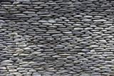 Fototapeta Kamienie - Rough stone wall texture.