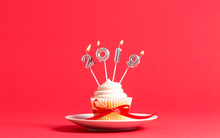 2019 New Year Celebration Theme With Cupcake And Candles