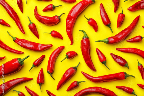 Fotografija Flat lay composition with fresh chili peppers on color background