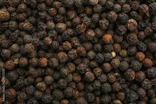 Foto op Plexiglas Kruiden Black pepper corns as background. Natural spice