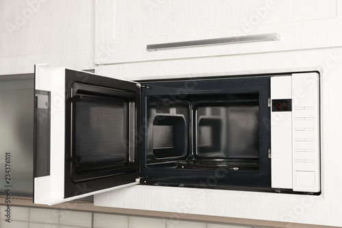Fotografía Open modern microwave oven built in kitchen furniture