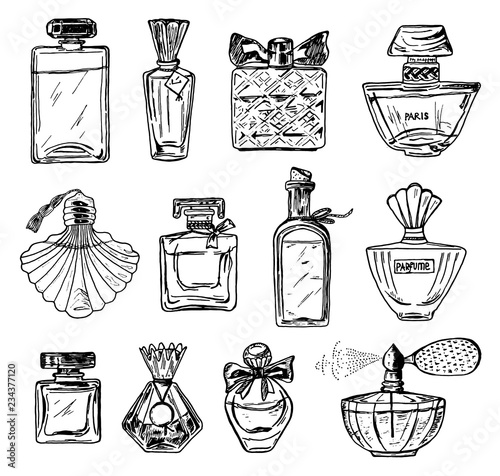 Fototapeta Set of Women's perfume in a bottle. Beautiful fashionable glass accessory. Hand Drawn Sketch. Vintage style. obraz