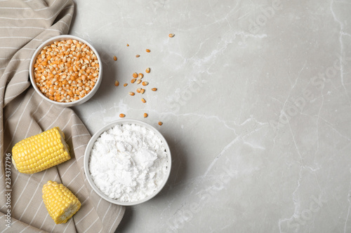 Flat lay composition with corn starch and space for text on grey background