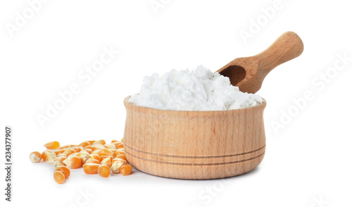 Bowl with corn starch and scoop on white background