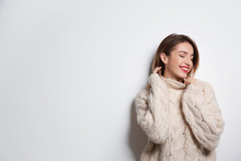 Beautiful Young Woman In Warm Sweater On White Background. Space For Text