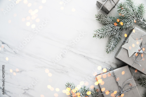 Spoed Fotobehang Kerstmis Christmas and New Year holiday background. Xmas greeting card. Christmas gifts on white marble background top view. Flat lay