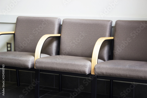 Fotografie, Obraz  Close up of row of empty chairs in office waiting room