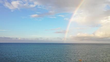 Amazing rainbow over the ocean, caribbean sea, Jamaica