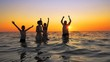 Family people are having a party spraing and jumping on the summer beach sunset, cinematic SLOW MOTION