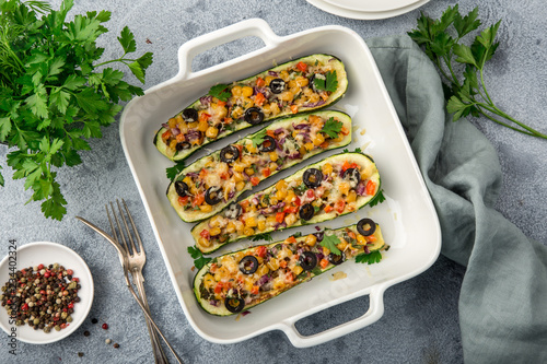 Stuffed zucchini boats with vegetables ( tomato, pepper, corn, red onion and oli Canvas Print