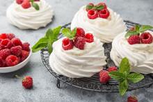 Mini Pavlova  Meringue Cakes With Whipped Cream And Fresh Raspberry