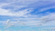 Time lapse of city landscapes with white clouds over blue sky.