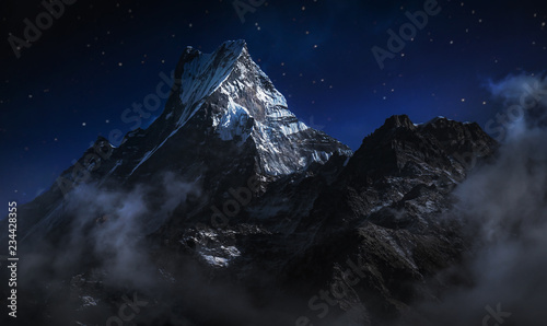Fototapeta Machapuchare at night. A mountain in the Annapurna Himalayas of north central Nepal. Digitally editing image obraz