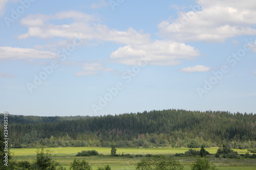 Spoed Foto op Canvas Khaki landscape with blue sky and clouds