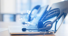 Close Up Soft Focus On Headset With Telephone Devices At Office Desk For Customer Service Support With Communication Icon Technology Concept