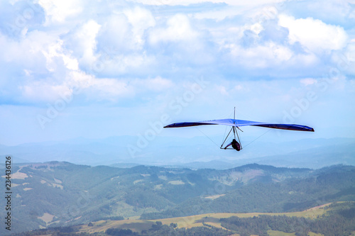 Canvas Prints Sky sports Light aircraft, deltaplane, against the sky with white clouds. deltaplane