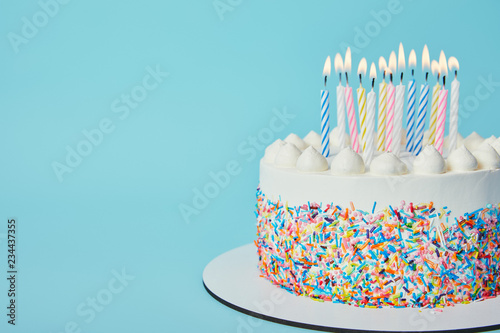 Delicious Birthday Cake With Lighting Candles On Blue Background