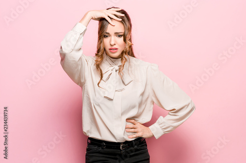 Fototapety, obrazy: Remember all. Let me think. Doubt concept. Doubtful, thoughtful woman remembering something. Young emotional woman. Human emotions, facial expression concept. Studio. Isolated on trendy pink