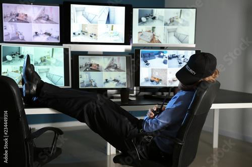 Stampa su Tela Security guard sleeping in surveillance room