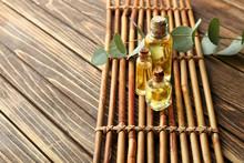 Bottles Of Eucalyptus Essential Oil On Wooden Background