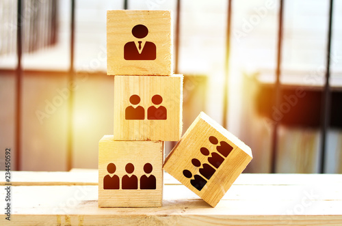 organization and team structure symbolized with big cubes and sun effect outdoor