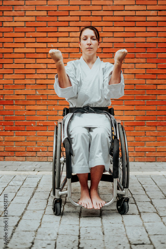 фотографія Woman who training karate with wheelchair