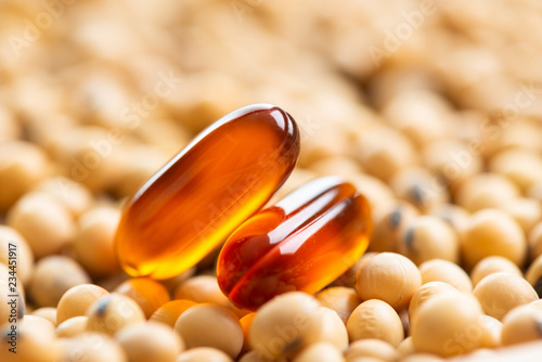 Fotografia, Obraz  Lecithin gel pills capsule with soy background
